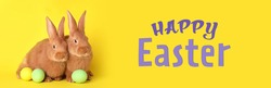 Happy Easter! Cute bunnies and dyed eggs on yellow background, banner design