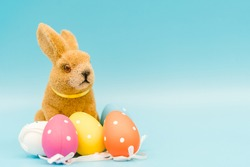 Happy Easter day.Bunny and easter egg.Colorful eggs.Rabbit on Holiday, Easter background .Spring season.Happy easter banner blue background.Egg hunt in church, Holiday.Advertise background for design.
