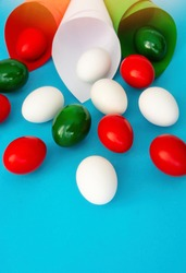 Happy Easter holiday card, Easter eggs as the color of the Italian flag - green, white, red