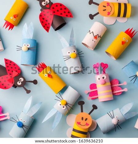 Happy easter kindergarten decoration concept - rabbit, chicken, egg, bee from toilet paper roll tube. Simple diy creative idea. Eco-friendly reuse recycle decor, daycare paper craft