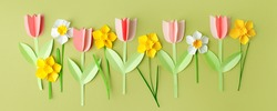 Happy Easter paper craft for kids. Paper DIY seasonal flowers tulips pastel green background. Spring decor, reate art for children, daycare, kindergarten, flyer greeting card, holiday concept