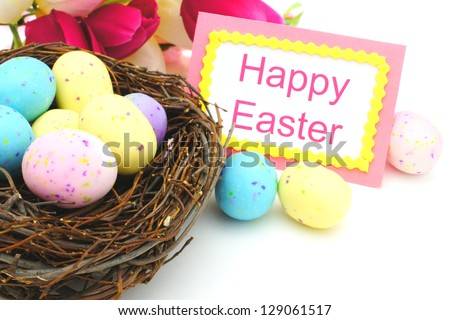 Happy Easter tag, springtime nest with eggs and flowers over white