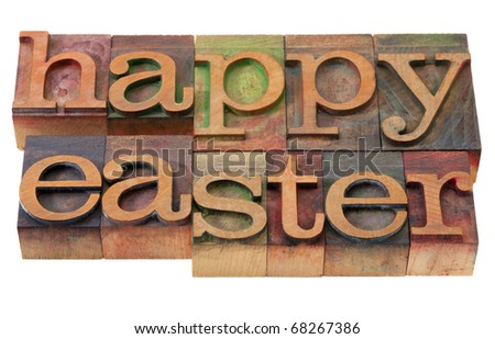 happy Easter- words in vintage wooden letterpress printing blocks, stained by color inks, isolated on white