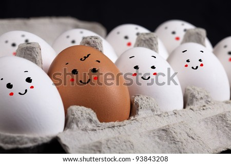 Happy eggs with smiley faces in eggshell