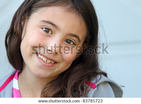 Happy eight year old child smiling - stock photo