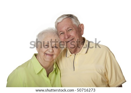 Happy elderly Caucasian couple posing on white background.