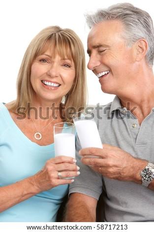 Happy elderly couple drinking milk, Over white background