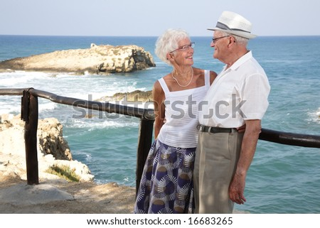 happy elderly couple having fun outdoors, looking in each other's eyes
