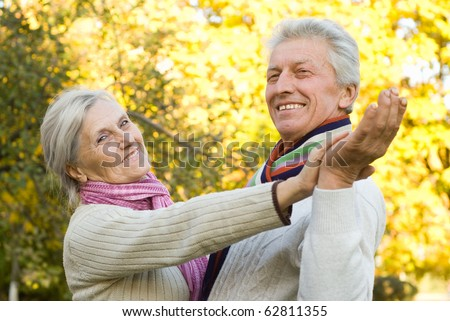 happy elderly couple in a autumn park
