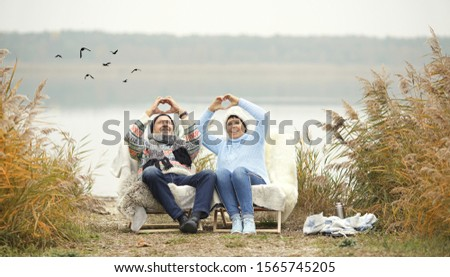 happy elderly couple in love - spend their time outside in winter stock photo
