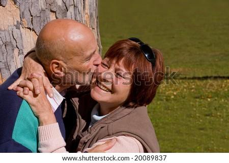 happy elderly couple kissing