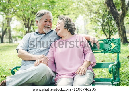Happy elderly couple with lifestyle after retiree concept. Lovely asian seniors couple embracing together in the park in the morning.