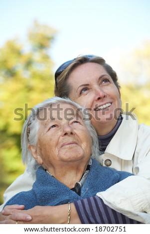 Happy elderly mother with her daughter