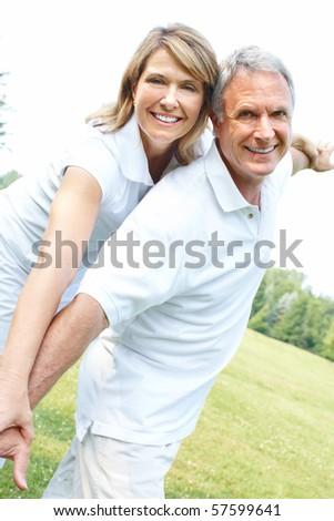 Happy elderly senior couple in park - stock photo