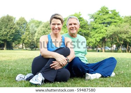 Happy elderly senior couple relaxing in the park