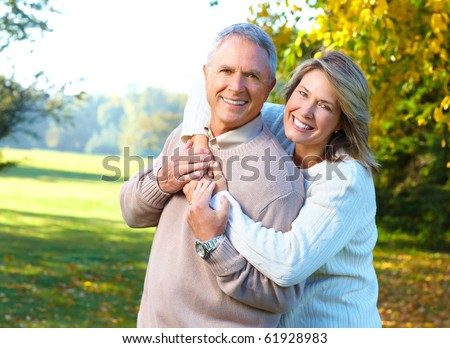 Happy elderly seniors couple in park #61928983