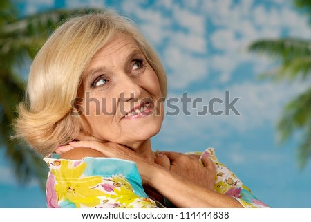 happy elderly woman smiling on a blue background