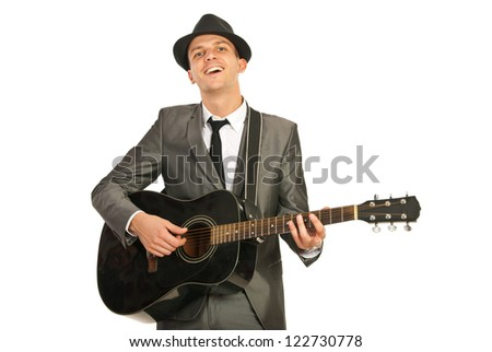 Happy elegant guy playing guitar isolated on white background