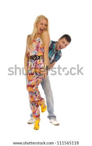 Happy emotional teenage couple isolated on white background