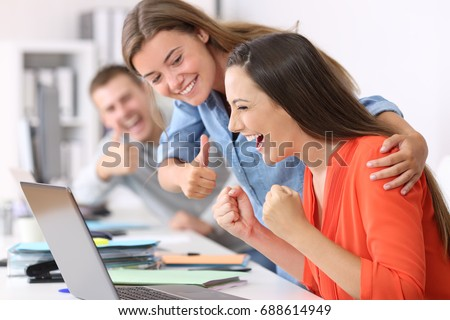Happy employee being congratulated by colleagues after success at office