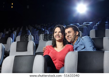 Happy enamoured at a cinema look a film