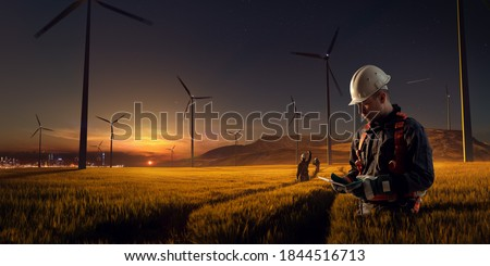 Happy engineer feel success after good work. He standing and looking beautiful sunset landscape. High quality photo Foto stock ©