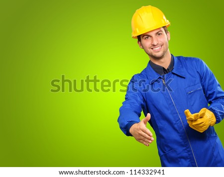 Happy Engineer Gesturing On Green Background