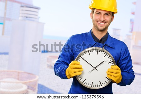 Happy Engineer Holding Wall Clock, Outdoors