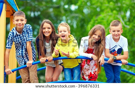 happy excited kids having fun together on playground #396876331