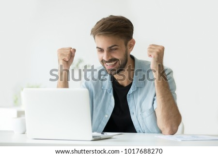 Happy excited man celebrating online win success achievement result looking at laptop screen, successful entrepreneur excited by good news in email, motivated by business win or new job opportunity