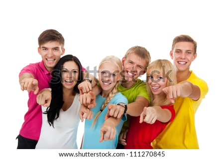 Happy excited smiling friends, group of young people students standing point finger at you together isolated on white background