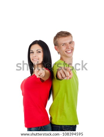 Happy excited smiling friends man and woman point finger at you gesture, young people students girl guy standing point finger hands at you together isolated on white background