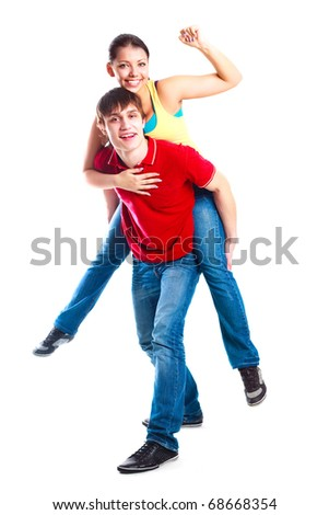 happy excited teenage couple, a boy giving a piggyback ride to his girlfriend