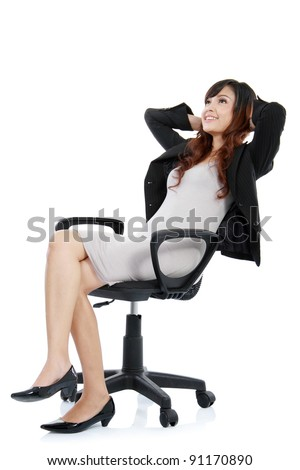 happy excited young businesswoman, relaxing in office chair, isolated on white
