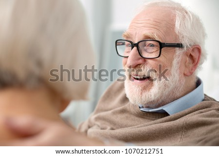 Happy face. Portrait of a delighted elderly man while showing his positive emotions #1070212751
