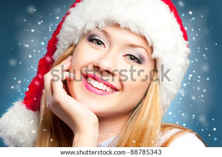 Happy face smiling woman in Santa Claus hat