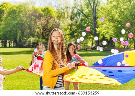 Happy fair-haired girl playing active game outside #639153259