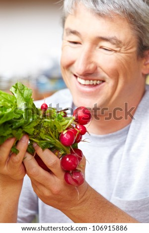 Happy famer selling his radish in a farm shop