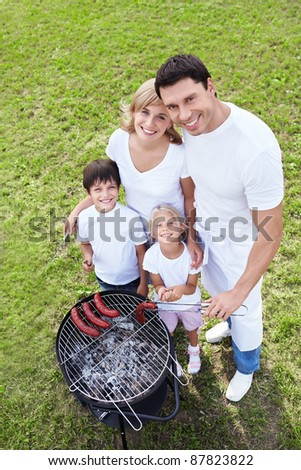 Happy families on a barbecue