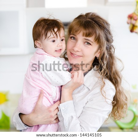 Happy family. A young mother and baby