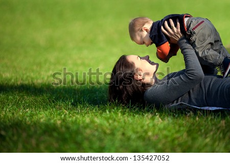 Happy family. A young mother and baby playing