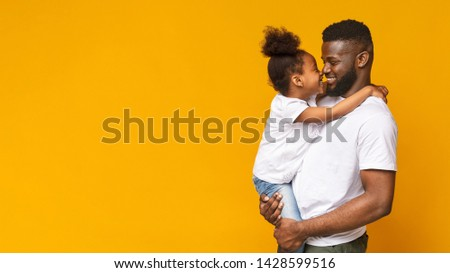 Happy family. Adorable little african girl touching noses with her daddy, orange panorama background with empty space #1428599516