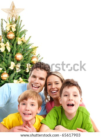 Happy family and a Christmas Tree.