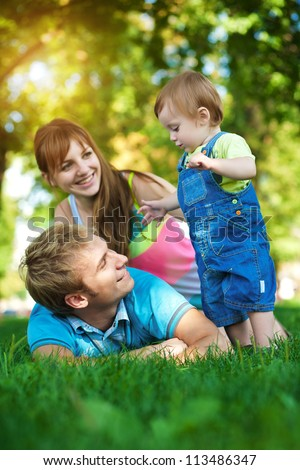 happy family are walking in the green summer park. picnic