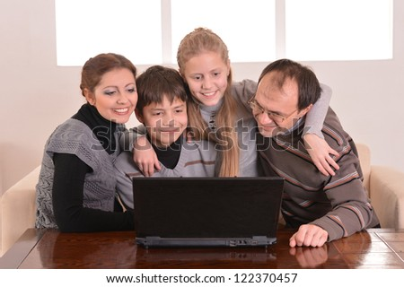 happy family at a laptop in the room