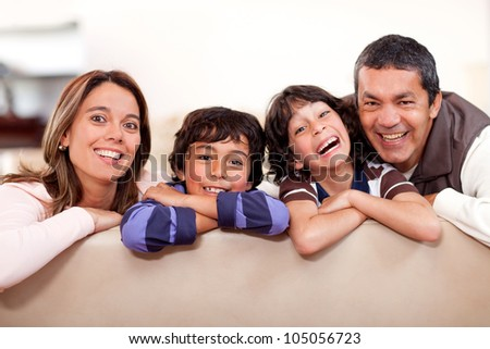 Happy family at home having fun and smiling