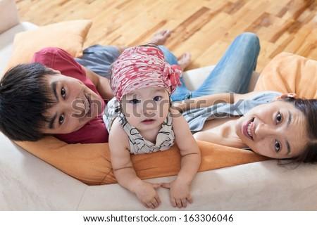 Happy family at home on sofa