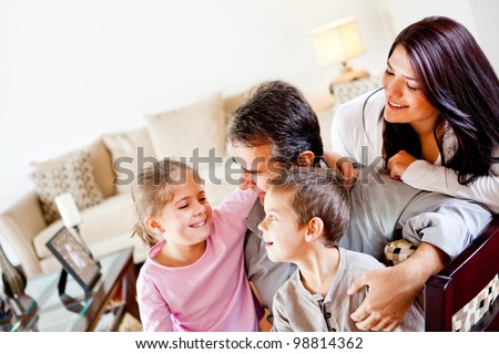 Happy family at home spending time together and smiling