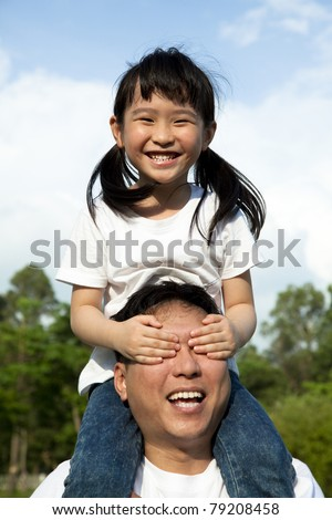 Happy family at park. girl and her father