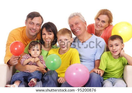 happy family at sofa sitting with baloons